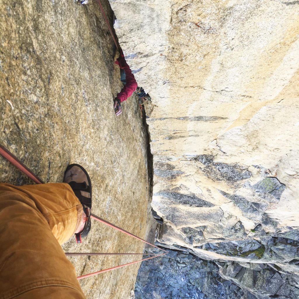 The hand emerges from the void on the first crux pitch